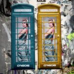 Two ladies in two phoneboxes